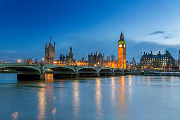 Westminster Palace in London at dusk View of The Houses of Parliament at dusk. london england stock pictures, royalty-free photos & images