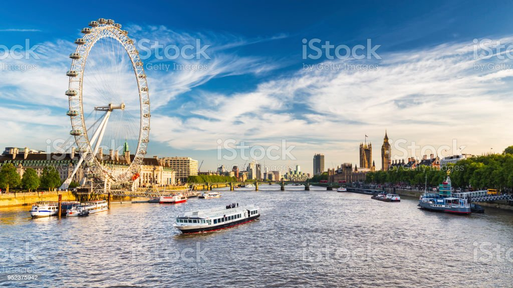 Westminster Parliament, Big Ben and the Thames with blue sky stock photo