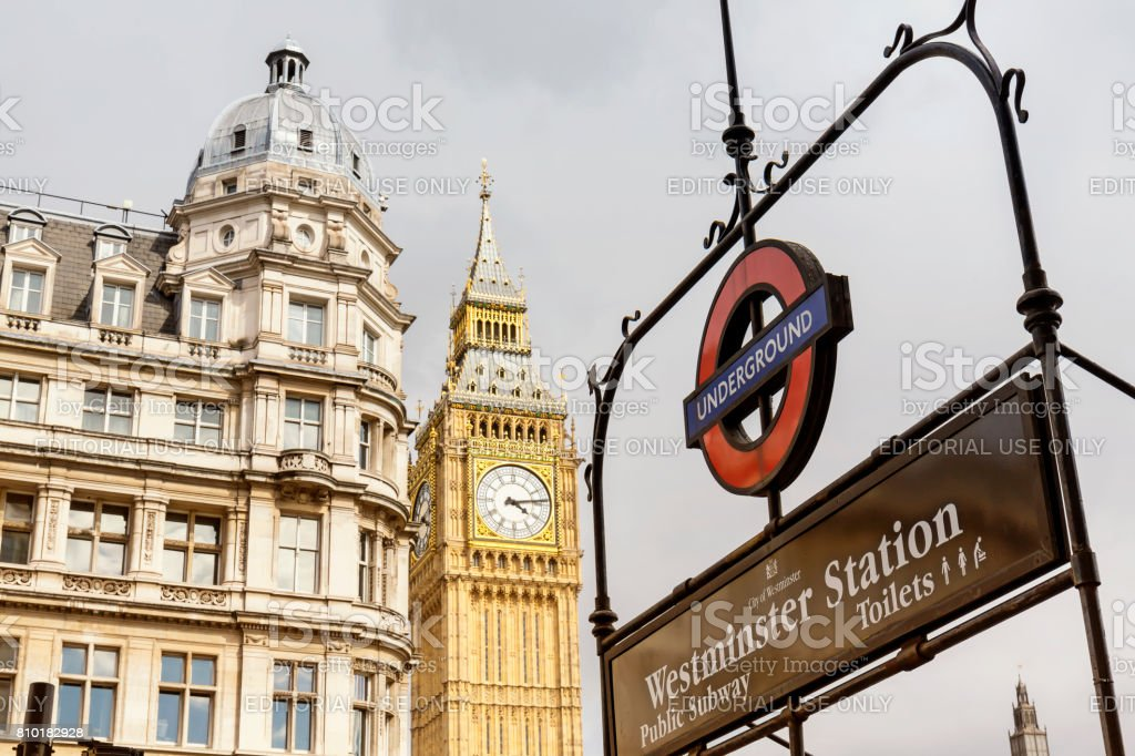 Westminster Station entrance and Big Ben in London at day. stock photo