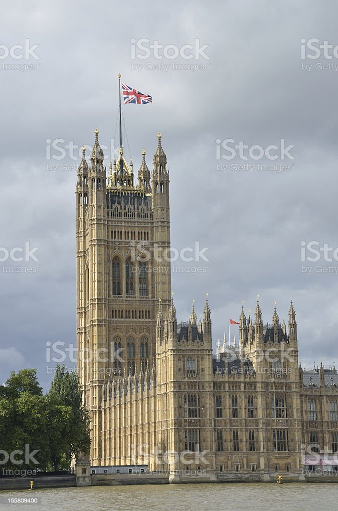 Westminster Tower with flag royalty-free stock photo