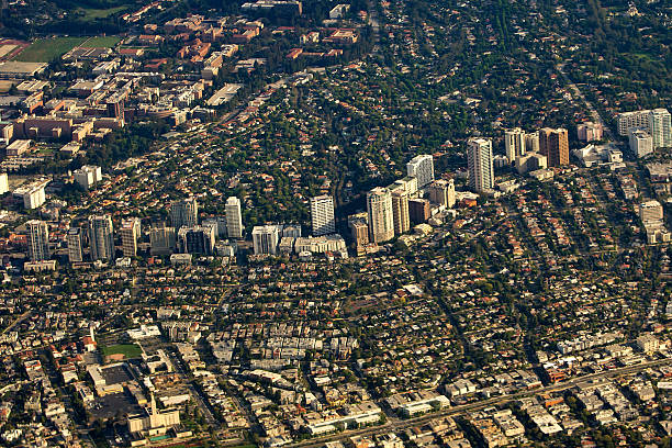 Westwood, Los Angeles, California, aerial view Aerial view of the Westwood neighborhood of Los Angeles, California, USA, looking northwest. A section of Wilshire Blvd known as Millionaire's Mile, Golden Mile or Wilshire Corridor in foreground is lined with high rise residential buildings. UCLA at upper left. ucla medical center stock pictures, royalty-free photos & images