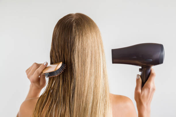 Wet and dry woman's blonde hair before and after using hair dryer on the gray background. Cares about a healthy and clean hair. Beauty salon concept. Wet and dry woman's blonde hair before and after using hair dryer on the gray background. Cares about a healthy and clean hair. Beauty salon concept. wet hair stock pictures, royalty-free photos & images