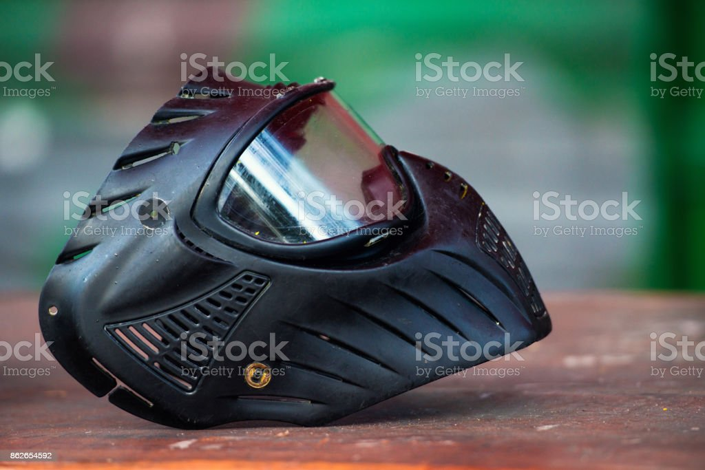 Wet and murdered in a paintball mask after the game stock photo