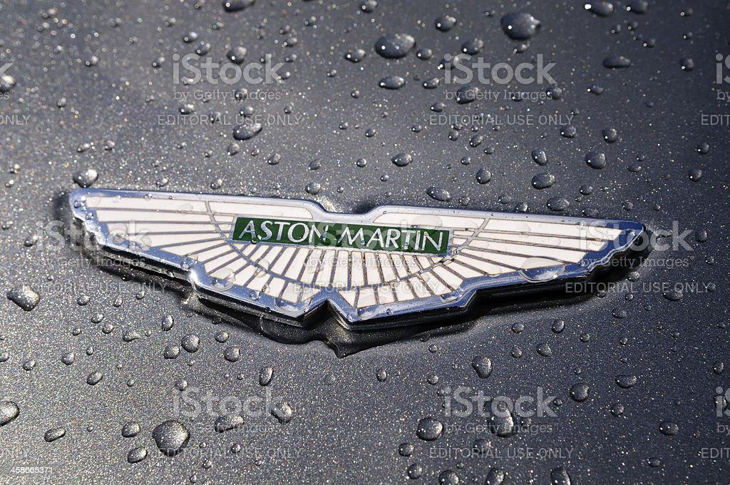 Wet Aston Martin badge on a DB7 sports car stock photo
