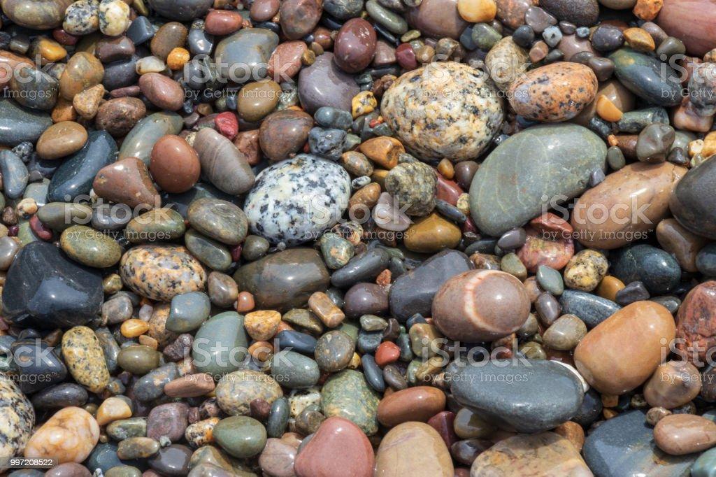 Wet Beach Pebbles. stock photo