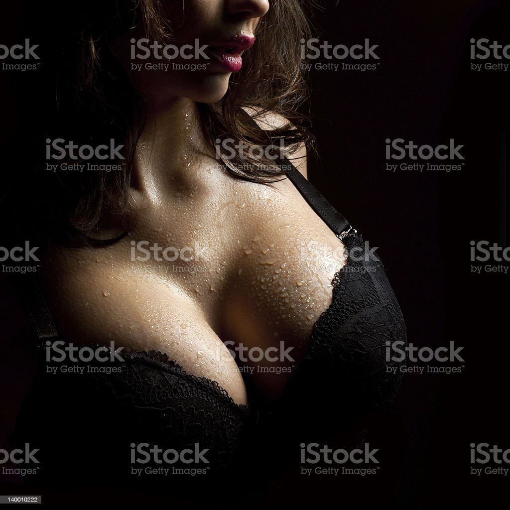Wet breast in bra bildbanksfoto