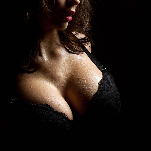 Wet breast in bra stock photo
