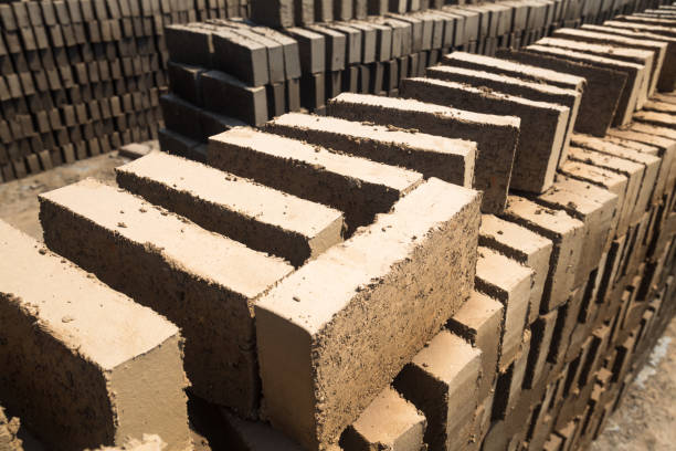 wet brick mud stack for natural dry stock photo