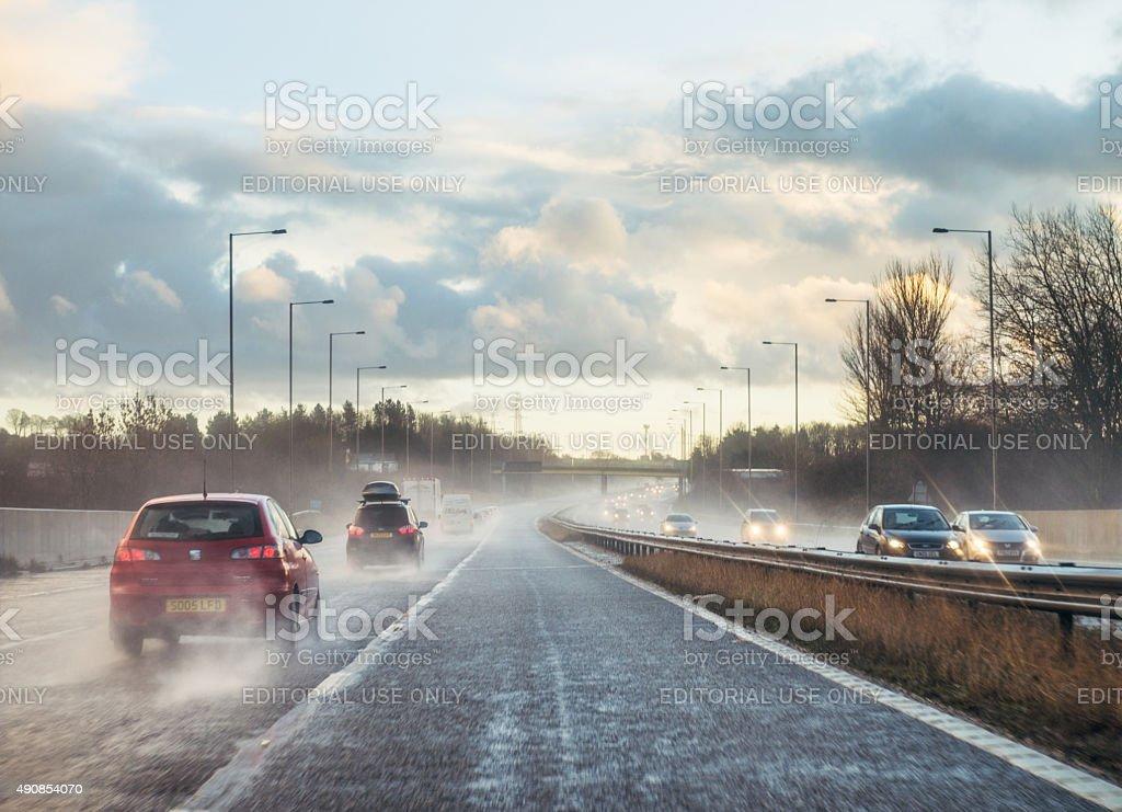 Wet British motorway traffic stock photo