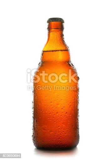 istock Wet brown beer bottle 823650694