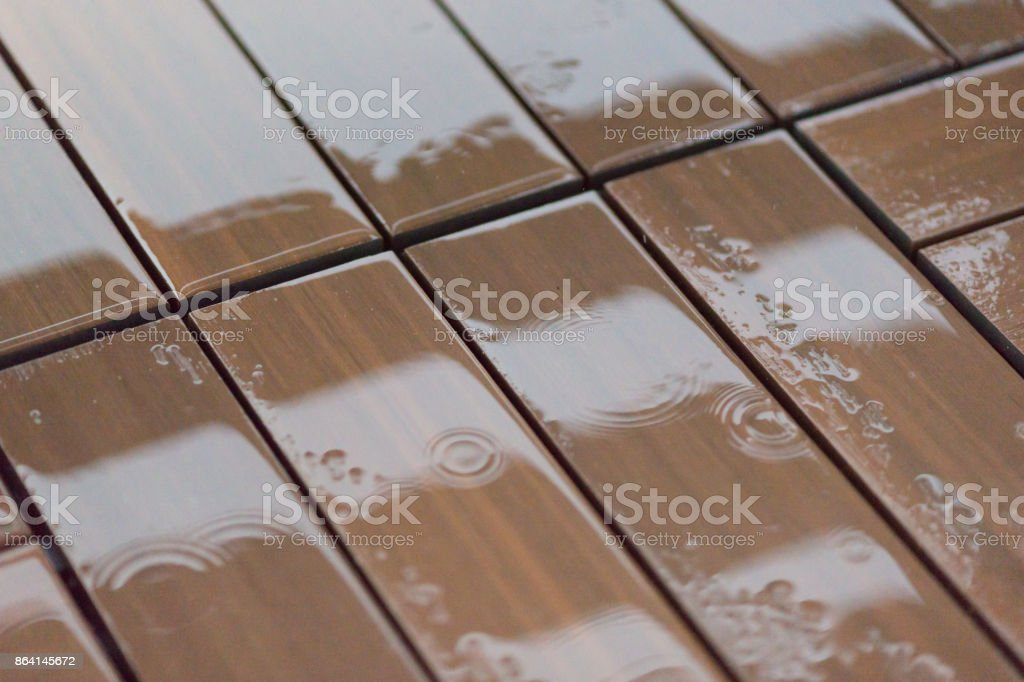 Wet brown wooden floor boards with water drops royalty-free stock photo