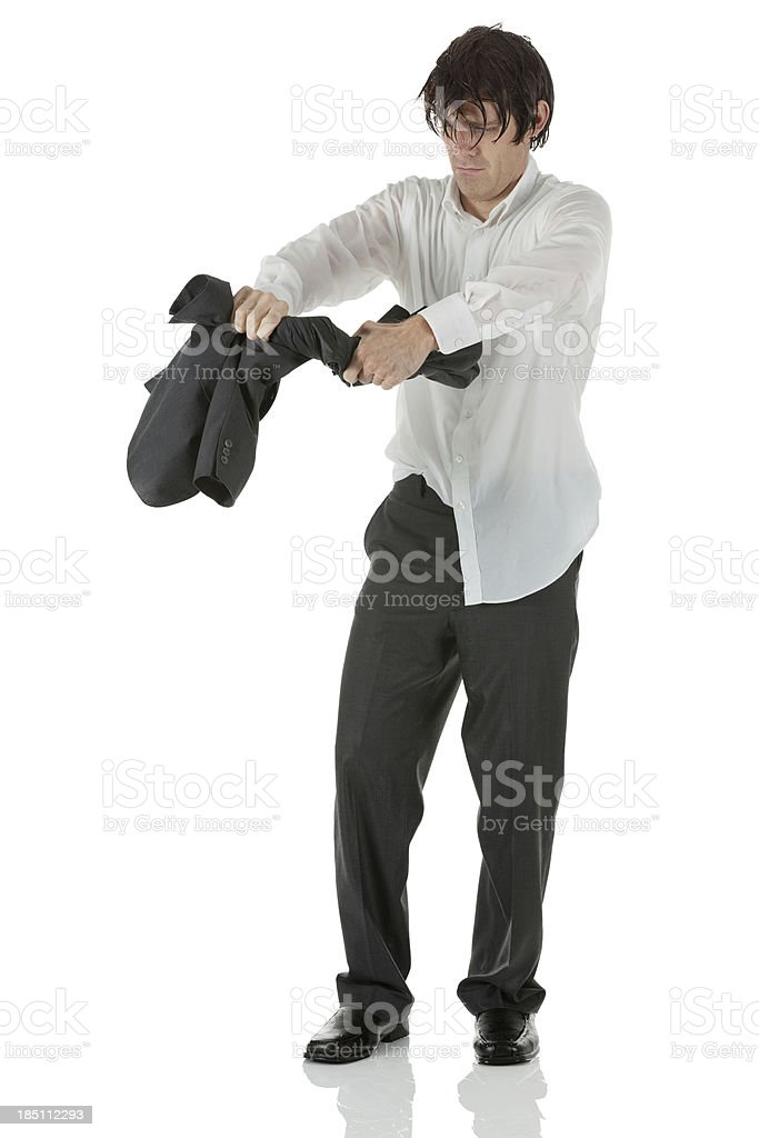 Wet businessman squeezing his coat stock photo
