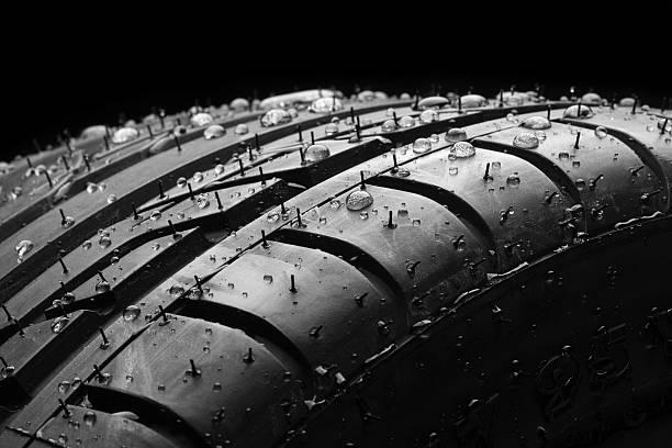 wet car tire macro on black - wheel black background bildbanksfoton och bilder