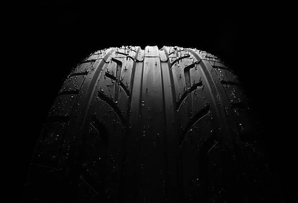 wet car tire on black macro - wheel black background bildbanksfoton och bilder