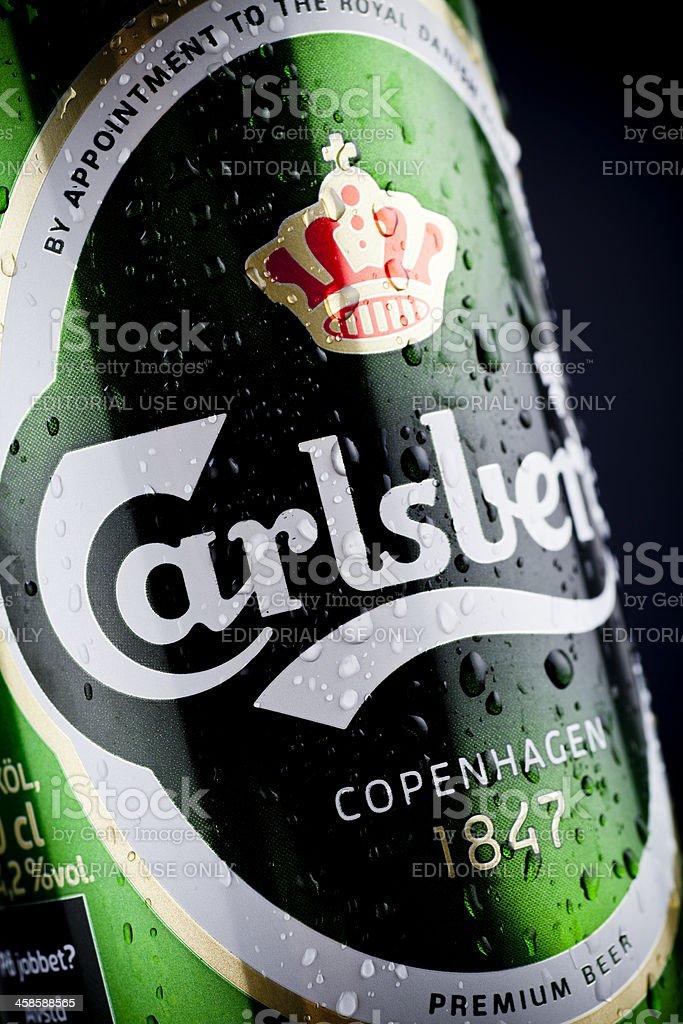Wet Carlsberg Hof Beer Can On Dark Background Stock Photo