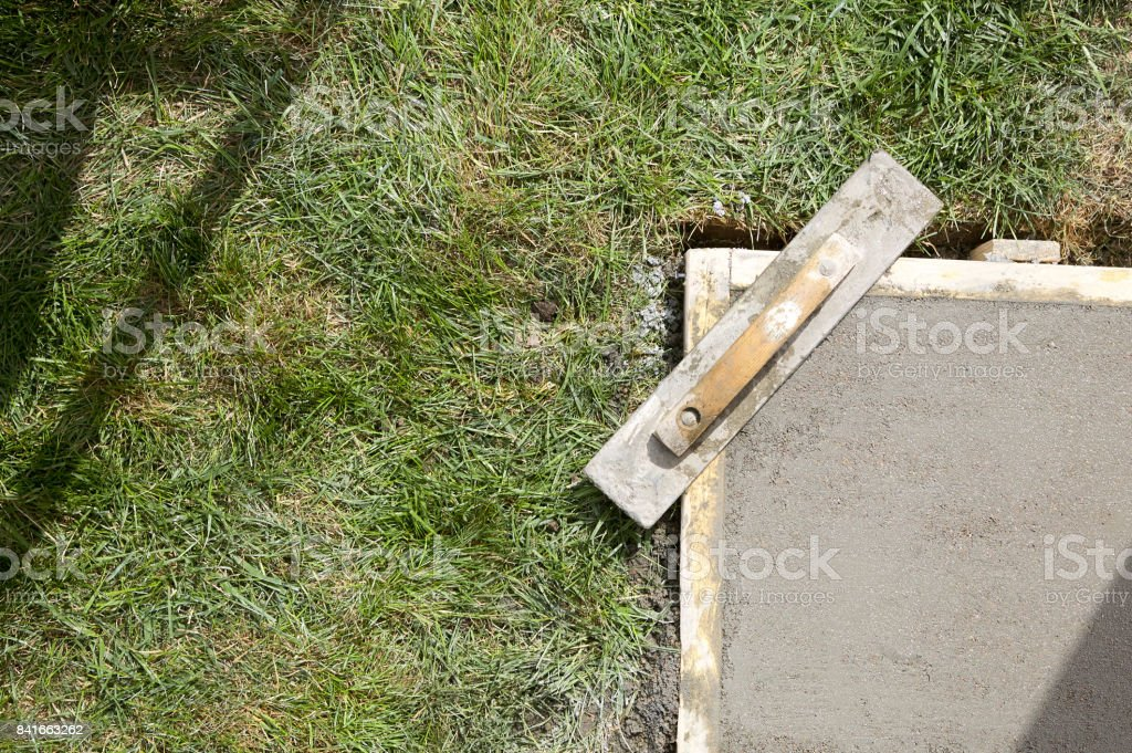 Wet cement slab form work and trowel float stock photo