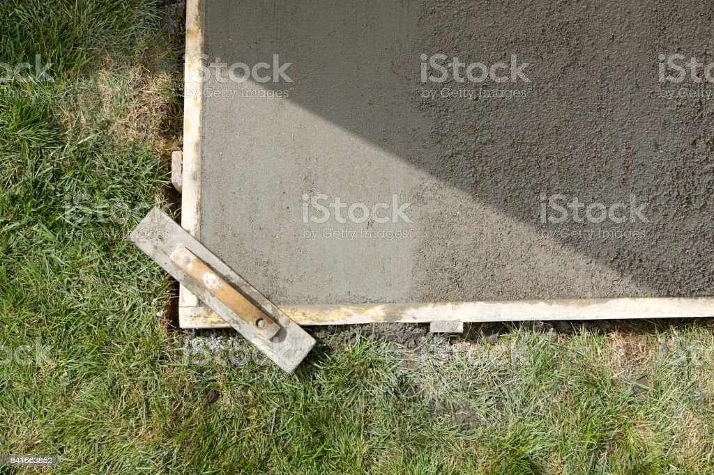 Wet cement slab form work and wooden screed stock photo