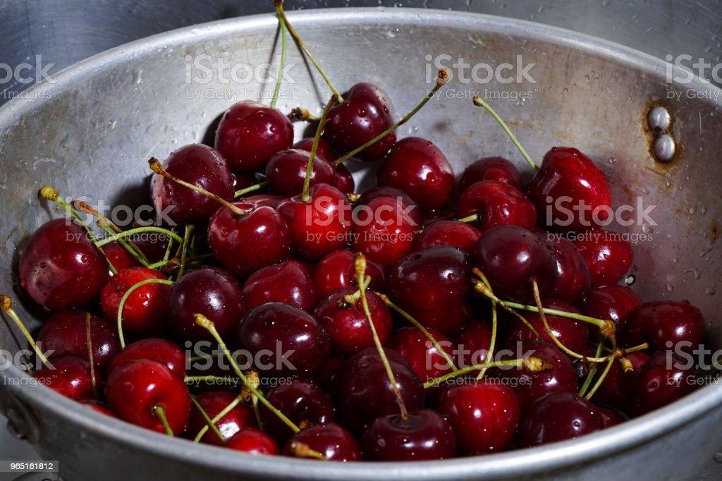 Wet Cherries In Sieve royalty-free stock photo
