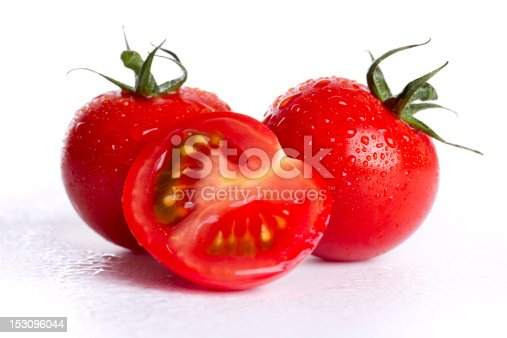 wet cherry tomatoes on white background