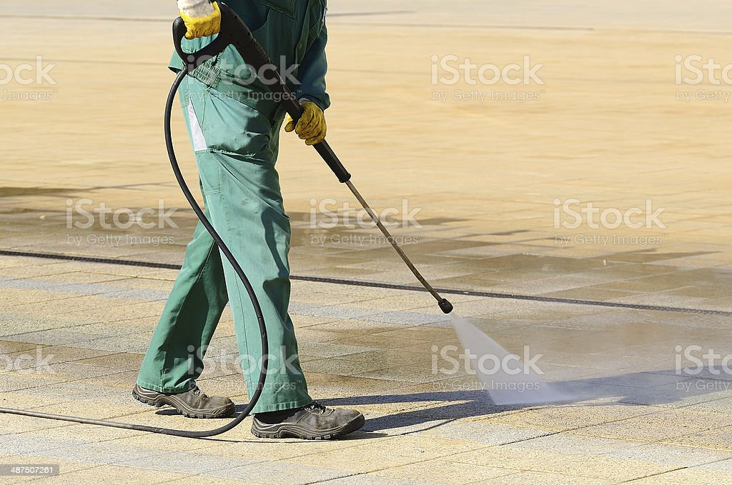 Wet cleaning of city streets stock photo