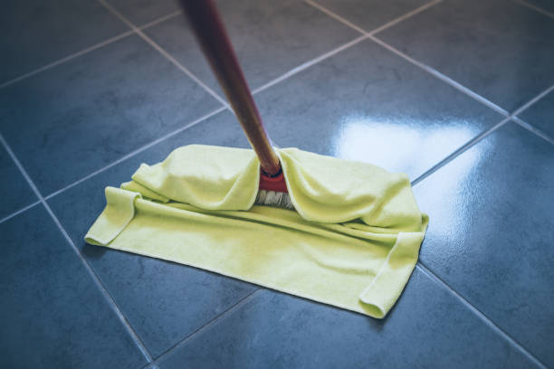 wet cleaning stone floor with floor cleaning cloth - rag stock pictures, royalty-free photos & images