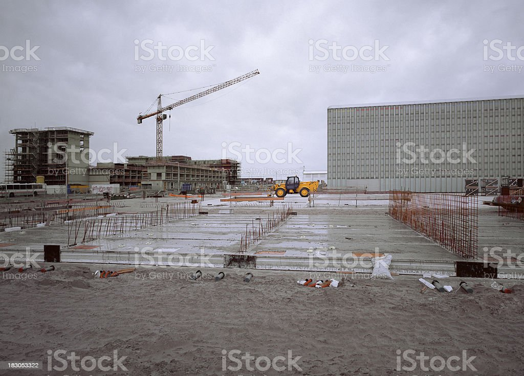Wet construction site with concrete foundations. stock photo