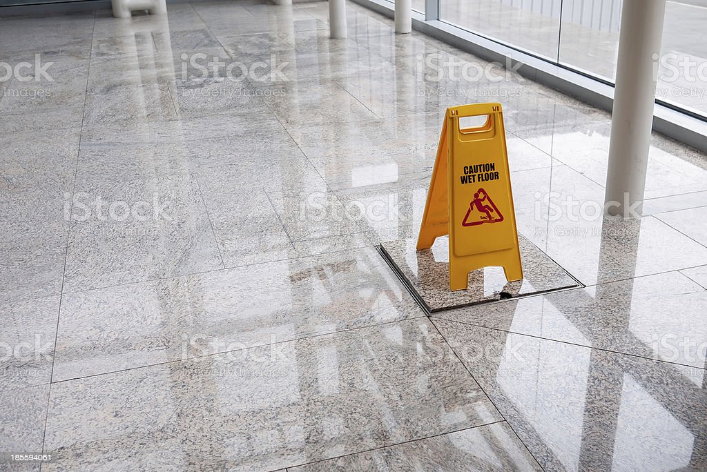 wet floor sign on lobby stock photo