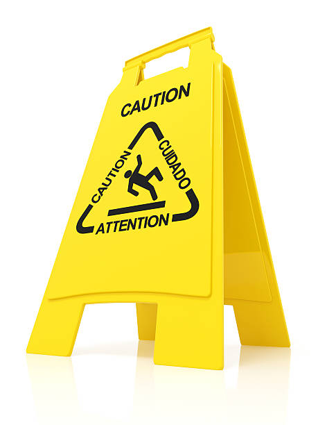 wet floor sign - fall prevention stock photos and pictures