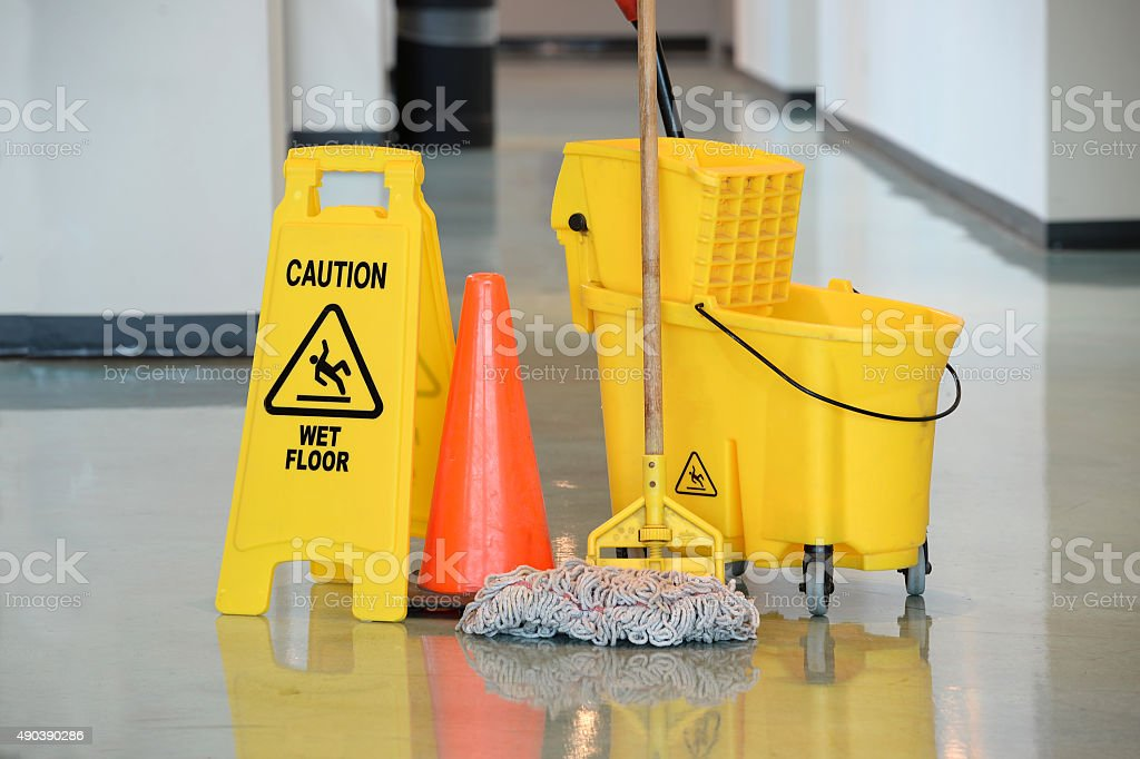 Wet Floor Sign With Mop stock photo
