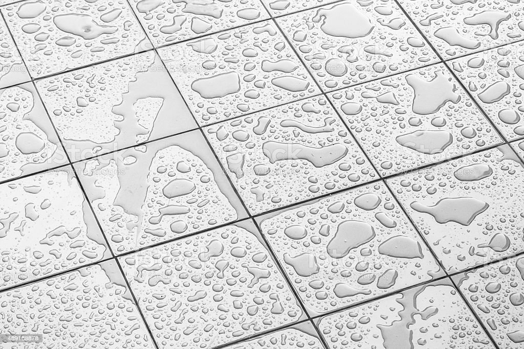 Wet Floor Square Tile stock photo