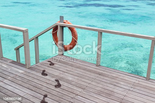 holiday and relaxation concept on a tropical destination during a sunny day. Turquoise water as background