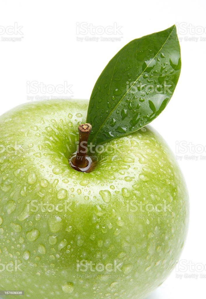 Wet fresh green apple with water droplets royalty-free stock photo