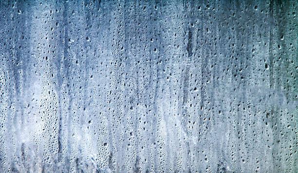 Wet Glass with Water Drops stock photo