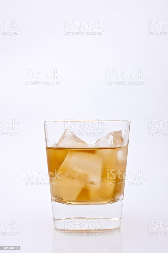 Wet Glass With Whisky And Ice royalty-free stock photo