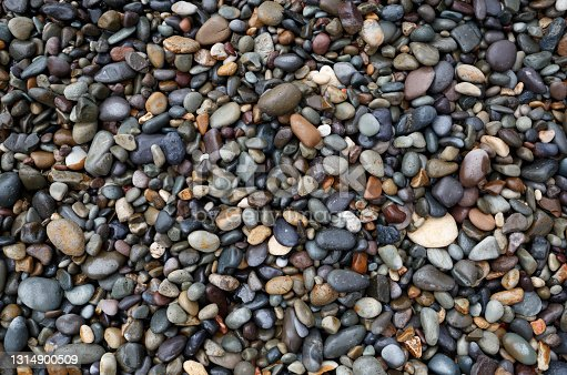 wet gray pebbles on the seashore. great background for design.