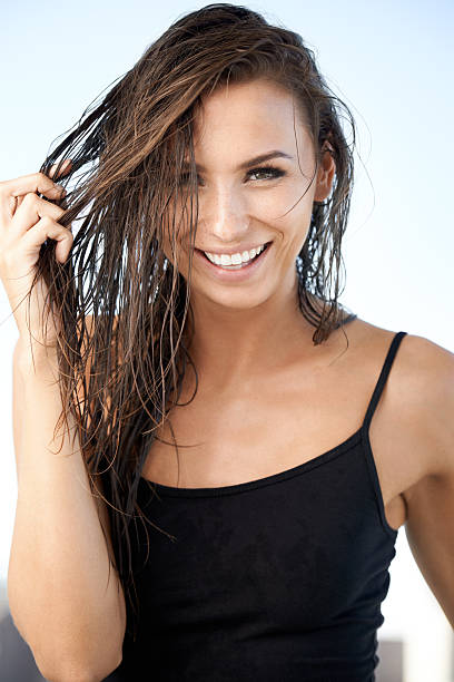 Wet hair, don't care Portrait of a gorgeous young woman gently pulling her wet hairhttp://195.154.178.81/DATA/istock_collage/0/shoots/782260.jpg wet hair stock pictures, royalty-free photos & images