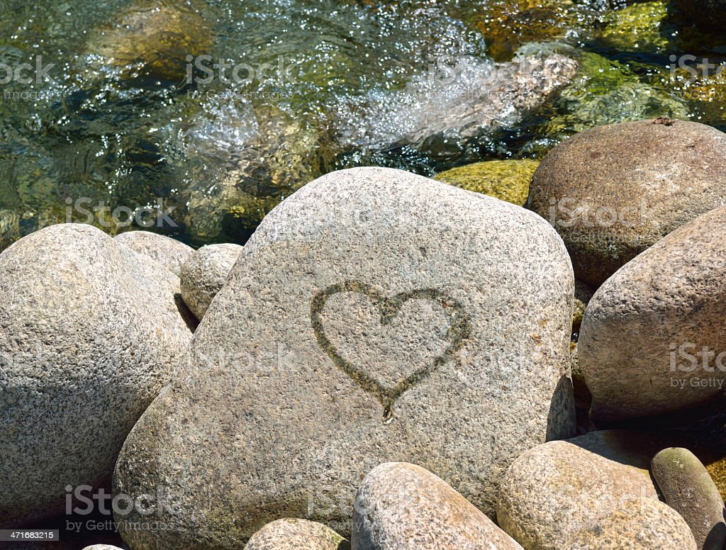 Wet heart on stone royalty-free stock photo