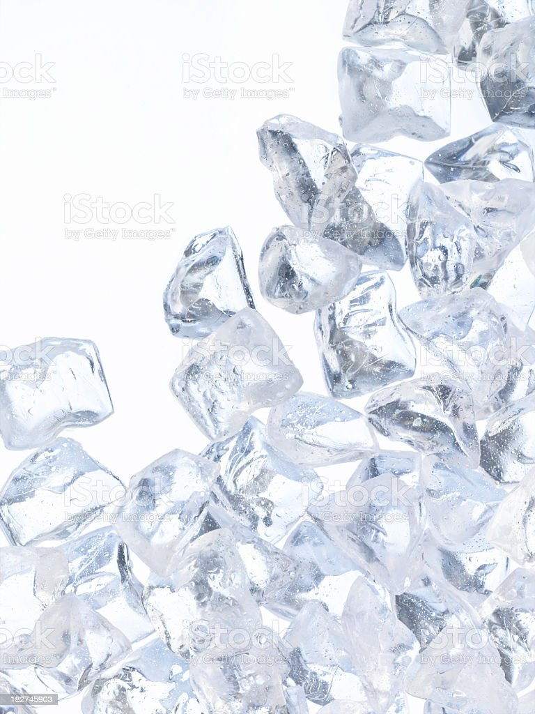 Wet ice cubes against a white background stock photo