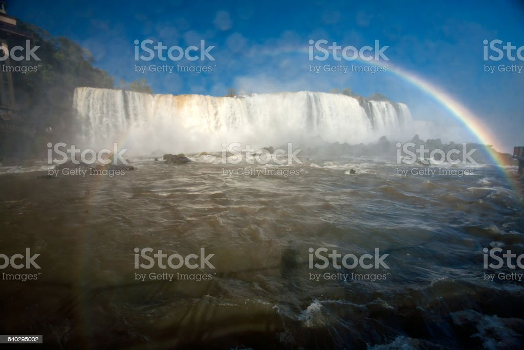 Wet lens - Rainbow in Iguazu falls national park stock photo