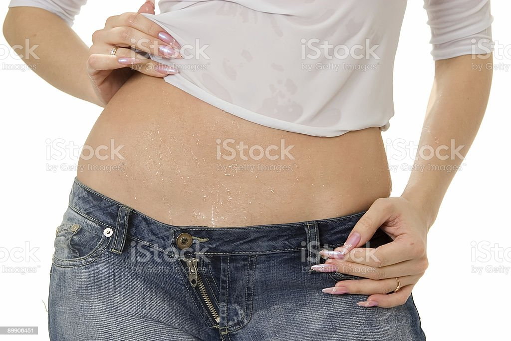 Wet naked female belly. royalty free stockfoto