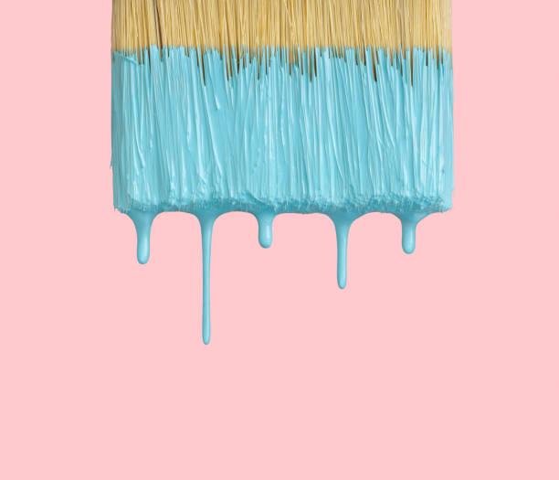 wet paintbrush closeup on pink with clipping path - один объект стоковые фото и изображения