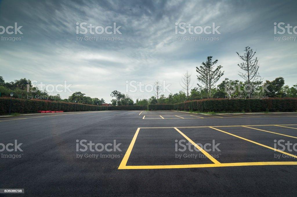 wet parking lot with black asphalt after rain stock photo