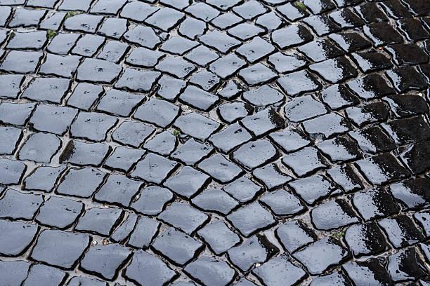 Wet pavement stone block stock photo