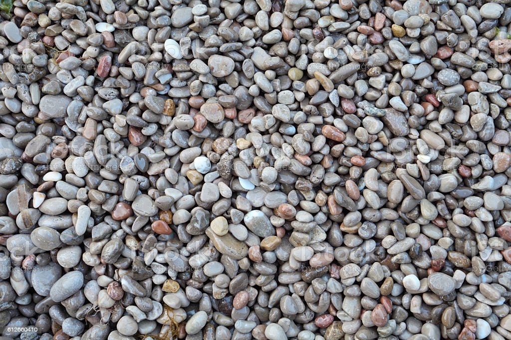 wet pebble stones abstract background stock photo