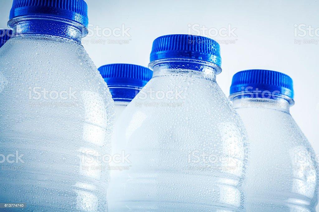 Wet plastic water bottles isolated on white background stock photo