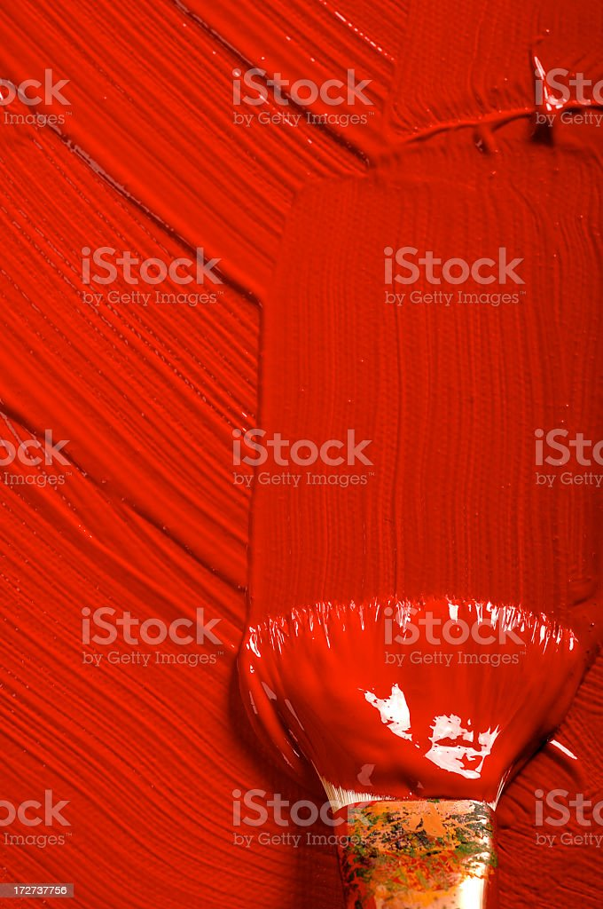 Wet red paint with brush streaks and brush stock photo