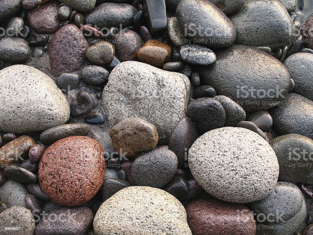 wet river rocks of various textures and colors stock photo