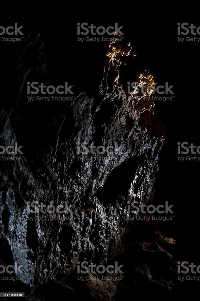 wet rocks in cave stock photo