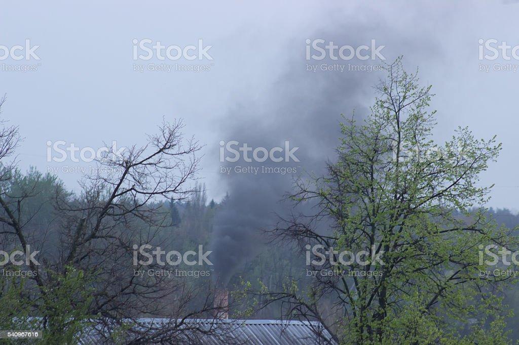 wet roofs, burning house stock photo