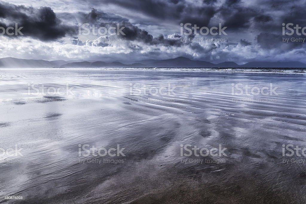 Wet sand, sea and storm clouds, Dingle Peninsula,  Ireland stock photo